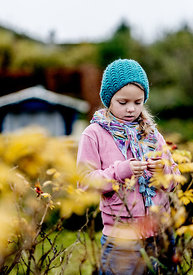 Little Danish girl in a blue hat in autumn 2