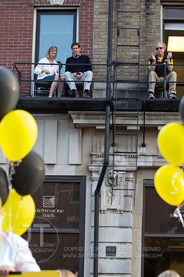 Spectators watch the University of Iowa homecoming Parade on Washington St in Iowa City on Friday September 28, 2012. (Justin...