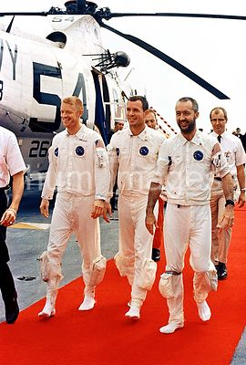 13 March 1969 - The Apollo 9 crew men walk on a red carpet after arriving aboard the prime recovery ship, USS Guadalcanal. L ...