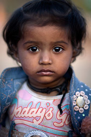 Toddler with piercing gaze in Pushkar, Rajasthan, India