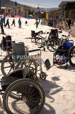 Wheelchairs at an adaptive snow ski program