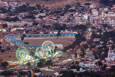 Aerial view of the Hindu holy city of Pushkar in the state of Rajasthan, India. Nighttime view including the ferris wheels at...