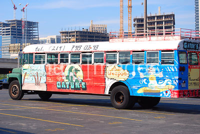 Gator's Restaurant bus in downtown Dallas parking lot (skyscrapers in background)