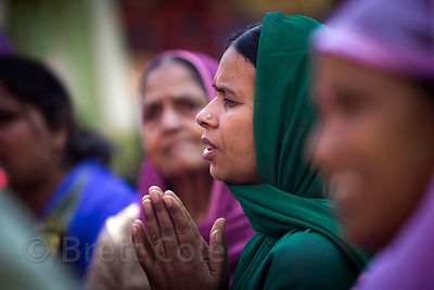 A woman prays during the Dussehra festival in Kullu, India