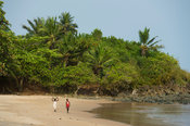Girls walking on the beach, near Busua, Ghana