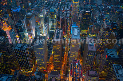 Night aerial view of the skyscrapers in Midtown Manhattan including many of the building of the Rockefeller Center