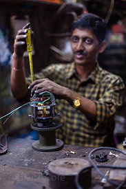A man works in his repair shop in the Kokri Agar slum, Mumbai, India.