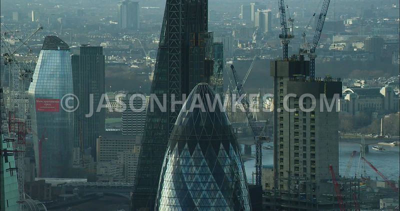 London Aerial footage, close up of St Mary's Axe towards Southbank with 1 Blackfriars Road.