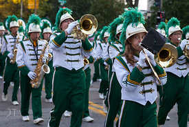 The West High Marching Band passes by on Clinton St during the  University of Iowa homecoming Parade in Iowa City on Friday S...