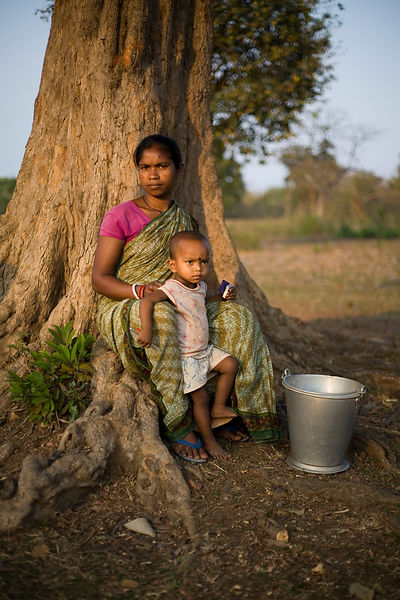 India - Orissa - A tribal woman and her child