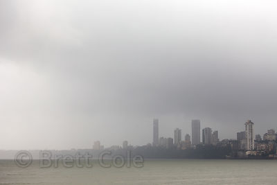 A rainstorm washes over the Arabian Sea and the Malabar Hill area of Mumbai, India. Taken from Chowpatty Beach.
