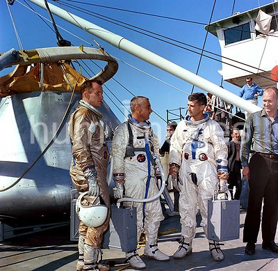 (27 Oct. 1966) --- The prime crew of the first manned Apollo Space Flight, ApolloSaturn (AS) mission 204, is suited up aboard...