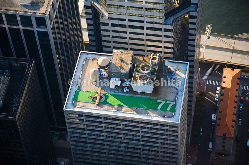 A replica of a World War 1 Sopwith Camel biplane is poised for a flight of fancy atop 77 Water Street, in the insurance distr...