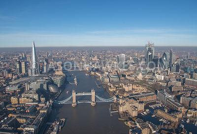 Aerial view looking along the River Thames with the Shard on one side and the skyscrapers of the City of London