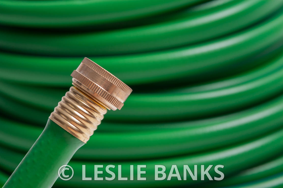 Green Garden Hose Isolated on White