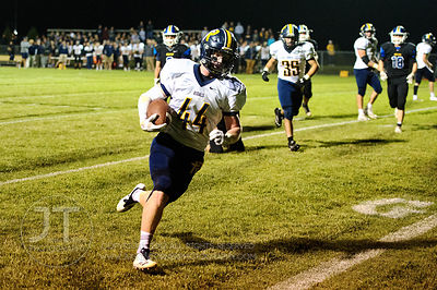 Iowa City Regina's Isaac Vollstedt (44) runs for a touchdown against Wilton during the first half of play in Wilton on Friday...