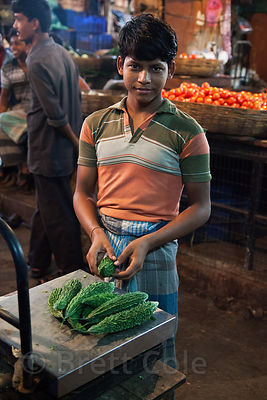 Worker at the indoor veg market, Newmarket, Kolkata, India