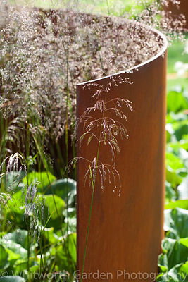 "The ""I am, because of who we are"" garden designed by Caroline Comber and Petra Horackova at the RHS Hampton Court Flower Show..."