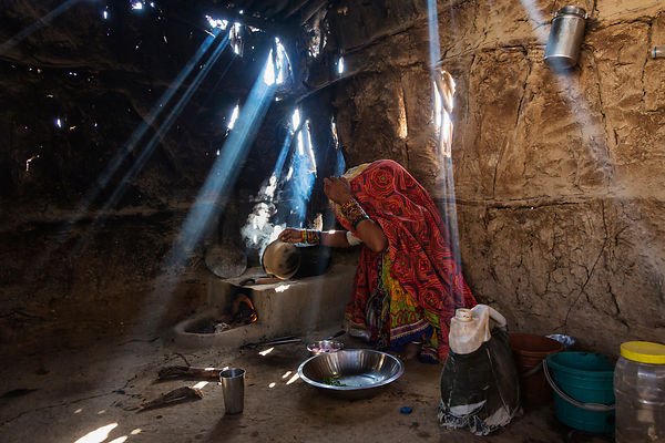 Woman Cooking insude Traditional Home