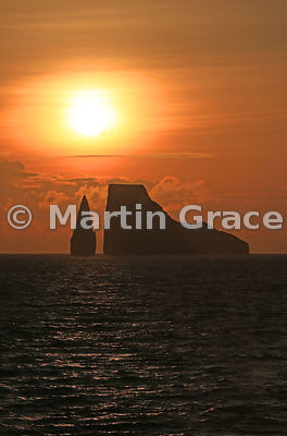 The sun setting behind Kicker Rock, Cerro Brujo, San Cristobal, Galapagos