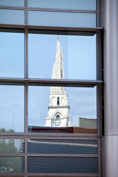UK - London - The spire of Christ Church reflected in an office building window, Spitalfields