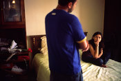 India - Delhi - A young Delhi couple talk in the bedroom at their flat