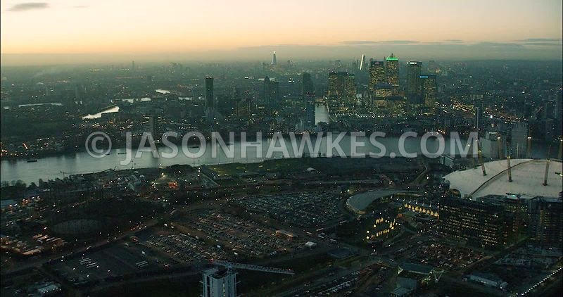 London Aerial Footage Greenwich Peninsula towards Docklands at night.