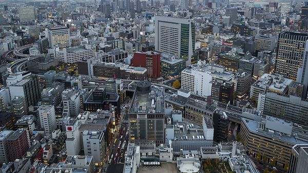 Bird's Eye: A Tight Shot of Tokyo Streets, Highways, & Buildings Coming Alive at Night (Day To Night)