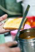 India - Delhi - Pavan Jain makes fruit sandwiches at the Jain Coffee House