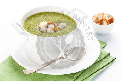 Broccoli soup with croutons on white background