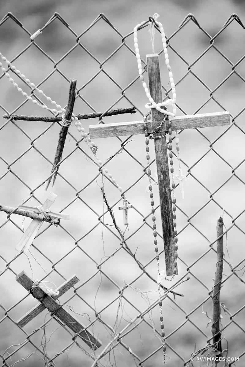CROSSES ON A FENCE NORTHERN NEW MEXICO BLACK AND WHITE