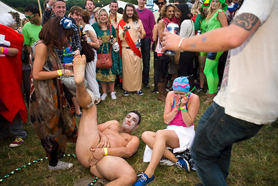 UK - Standon - A naked man collapses with a woman during dancing in a field at the Standon Calling Festival