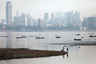 People and boats in Mahim Bay, Mumbai, India.