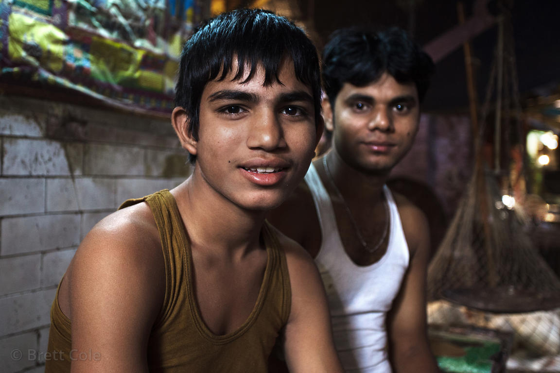 Workers at a chicken market, Newmarket, Kolkata, India.