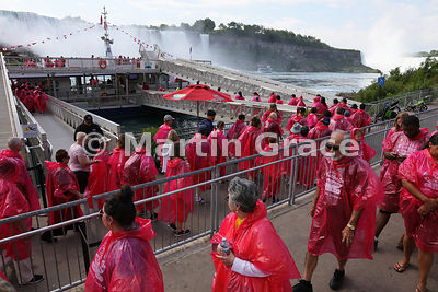 Tourists queueing to board the Hornblower Niagara Cruises' tourist vessel, Niagara Falls, Ontario, Canada with Maid of the Mi...