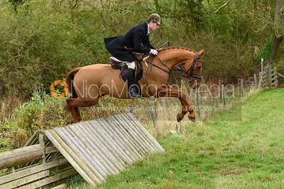 Angus Smales jumping a hunt jump near Peake's. The Cottesmore Hunt at Somerby