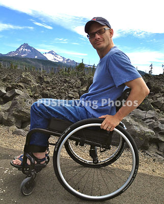 Man using a wheelchair in the lava fields of Central Oregon