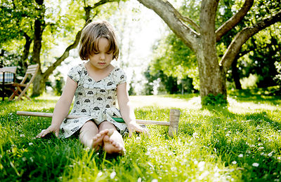 Girl sitting in the grass #1