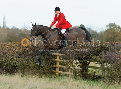 James Mossman MFH jumping a fence