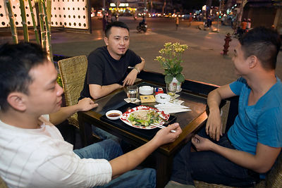 Friends dining in an upscale restaurant, Ho Chi Minh City, Vietnam