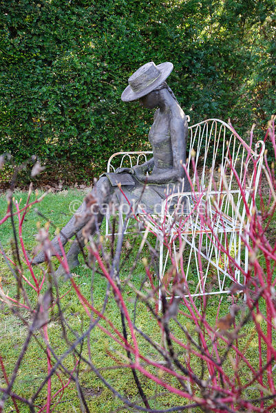 Sculpture of a woman reading a book at The Down House, Hampshire in winter