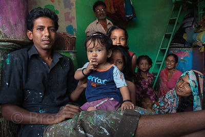 A family in their paint shop in the Dharavi slum, Mumbai, India.
