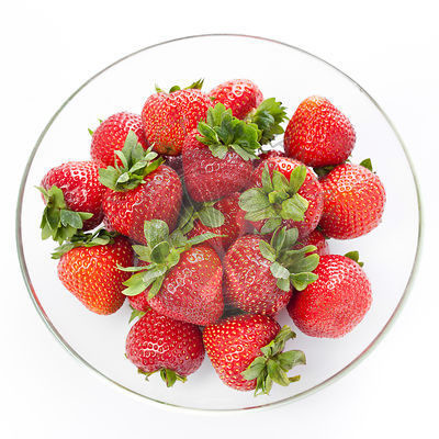 Strawberry in round plate on white background