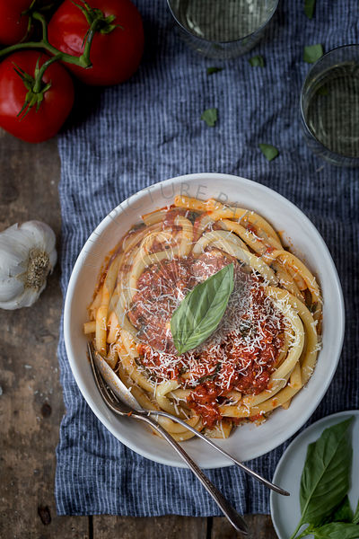 Spaghetti Topped off with tomato basil sauce