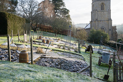 Formal kitchen garden on a sloping area of the garden, dusted with a sprinkling of snow.