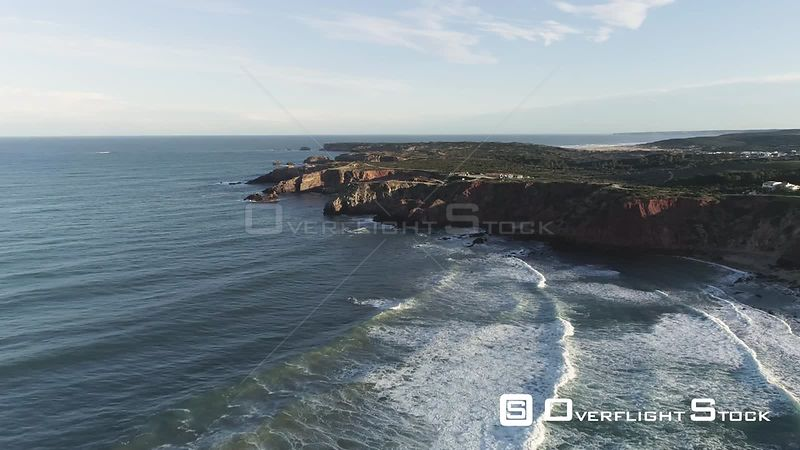 Aerial drone flying over rocky cliffs off the coast of Portugal