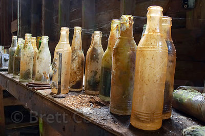 Soda bottles sit dusty and cob-webbed, untouched for 30 years in the defunct cannery of the Butedale ghost town, Great Bear R...