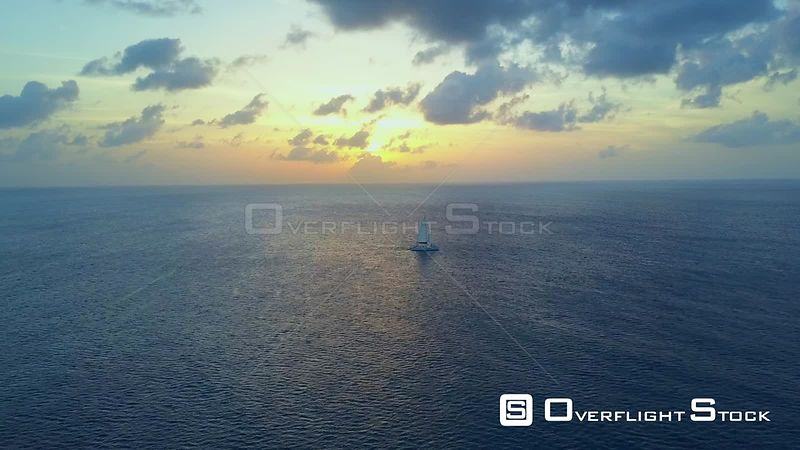 Catamaran Sailboat On Caribbean Ocean at Sunset  Cayman Islands