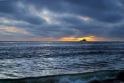 Wide view of sunset over Fan Island in the open Pacific Ocean. From Fan Point, Great Bear Rainforest, British Columbia