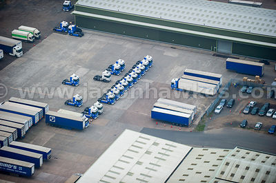 Aerial view of lorries at warehouse